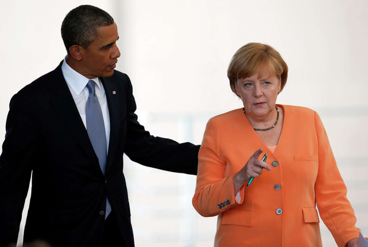 FILE - In this June 19, 2013, file photo, President Barack Obama, left, and German Chancellor Angela Merkel, right, arrive for a news conference at the chancellery in Berlin. Reports based on leaks from former NSA systems analyst Edward Snowden suggest the U.S. has monitored the telephone communications of 35 foreign leaders. The fact that Merkel was among them has been particularly troubling to many in Europe and on Capitol Hill, given her status as a senior stateswoman, the leader of Europe?'s strongest economy, and a key American ally on global economics, Iranian nuclear negotiations and the Afghanistan war. (AP Photo/Michael Sohn, File)