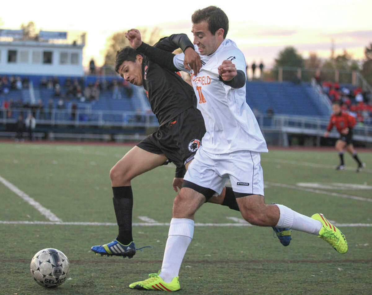 Photo by Chris Palermo Stamford's Jeffery Beltran, rear, grapples with Ridgefield's Sam Isaac during the FCIAC semifinals Monday night at Fairfield-Ludlowe.