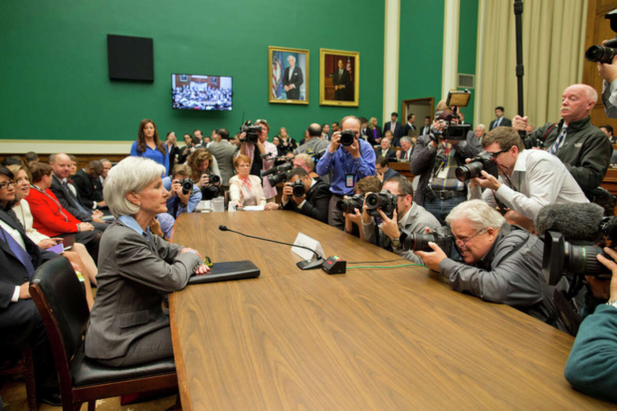 Health and Human Services Secretary Kathleen Sebelius is surrounded by photographers on Capitol Hill in Washington, Wednesday, Oct. 30, 2013, prior to testifying before the House Energy and Commerce Committee hearing on the difficulties plaguing the implementation of the Affordable Care Act. Sebelius, President Barack Obama's top health official faced tough questioning by a congressional committee Wednesday that will demand she explain how the administration stumbled so badly in its crippled online launch of the president's health care overhaul. (AP Photo/ Evan Vucci)