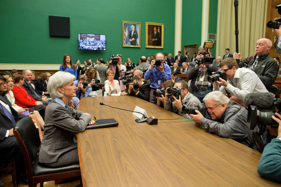 Health and Human Services Secretary Kathleen Sebelius is surrounded by photographers on Capitol Hill in Washington, Wednesday, Oct. 30, 2013, prior to testifying before the House Energy and Commerce Committee hearing on the difficulties plaguing the implementation of the Affordable Care Act. Sebelius, President Barack Obama's top health official faced tough questioning by a congressional committee Wednesday that will demand she explain how the administration stumbled so badly in its crippled online launch of the president's health care overhaul. (AP Photo/ Evan Vucci) / AP