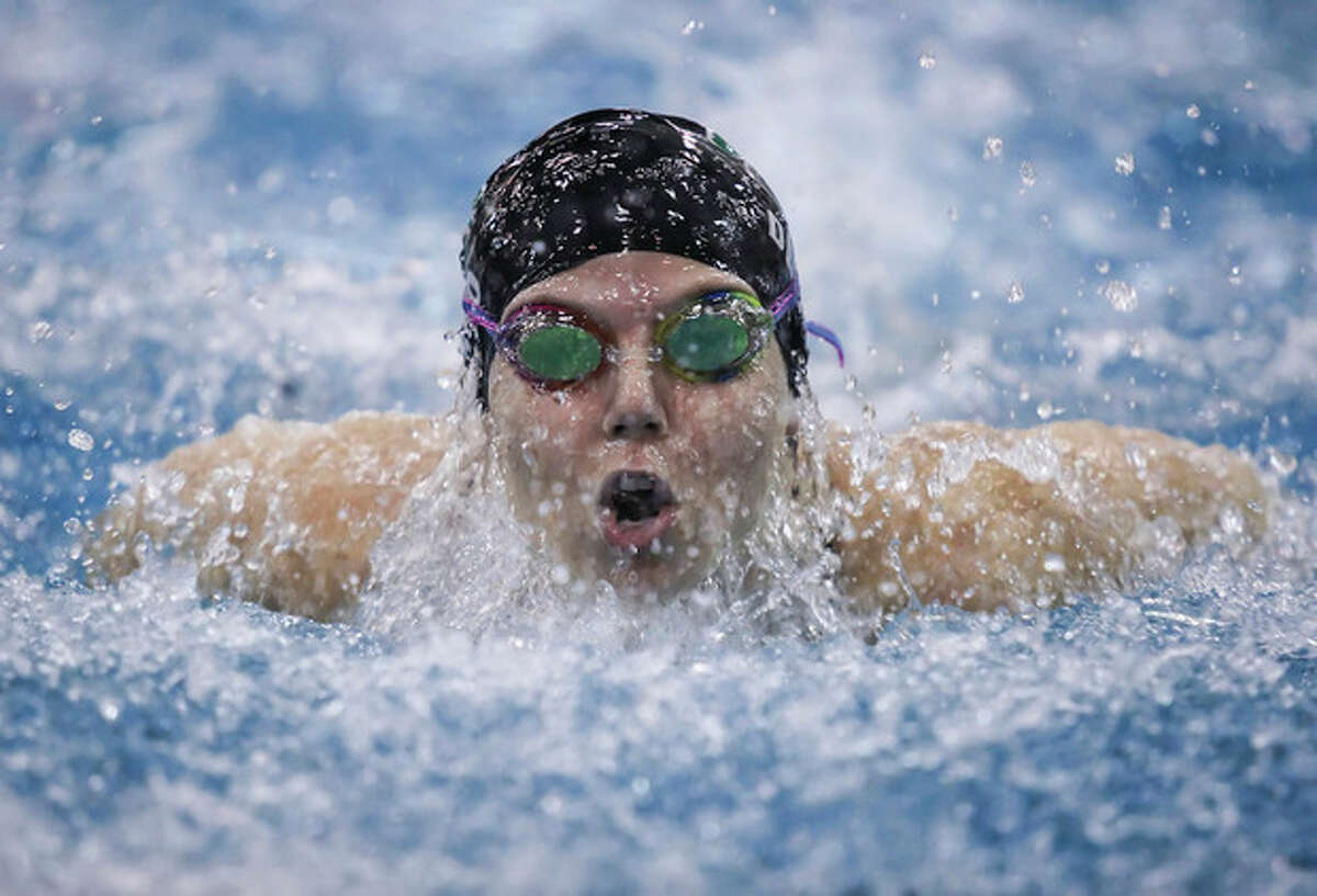 Hour Photo / Chris Palermo. Norwalk High School's Paige Delago competes in the 100 metre butterfly at the FCIAC swim championships held Wednesday at Greenwich High School.
