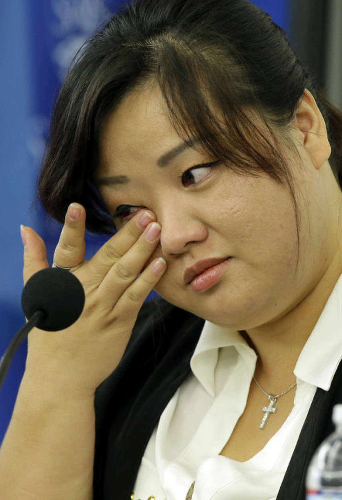 Jin hye Jo wipes a tear as she testifies during a hearing of the United Nations mandated Commission of Inquiry about the human rights situation in the Democratic People's Republic of Korea, at the Johns Hopkins School of Advanced International Studies, Wednesday, Oct. 30, 2013, in Washington. Jo wiped the tear while talking about her brother dying in her arms. (AP Photo/Alex Brandon)