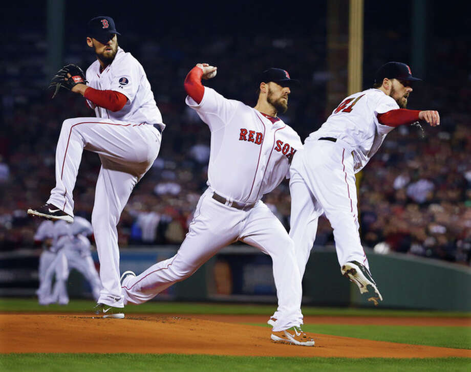In a multiple exposure, Boston Red Sox starting pitcher John Lackey throws during the first inning of Game 6 of baseball's World Series against the St. Louis Cardinals Wednesday, Oct. 30, 2013, in Boston. (AP Photo/Matt Slocum) / AP