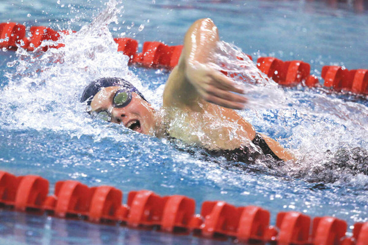 Hour Photo / Chris Palermo. Staple's Verity Able competes in the 500 metre freestyle championship heat at the FCIAC swim championships held Wednesday at Greenwich High School. Verity won the race with a time of 4:53.48 and setting a new FCIAC record.