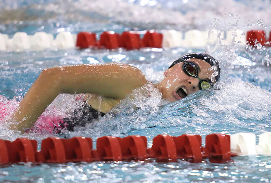 Hour Photo / Chris PalermoNorwalk High School's Lauren Czulewicz cmpetes in the 500 metre freestyle at the FCIAC swim championships held Wednesday at Greenwich High School. / © 2013 Hour Newspapers All Rights Reserved