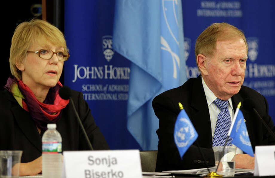 Commission members Sonja Biserko, left, and Michael Kirby, listen during a hearing of the United Nations mandated Commission of Inquiry about the human rights situation in the Democratic People's Republic of Korea, at the Johns Hopkins School of Advanced International Studies, Wednesday, Oct. 30, 2013, in Washington. (AP Photo/Alex Brandon) / AP