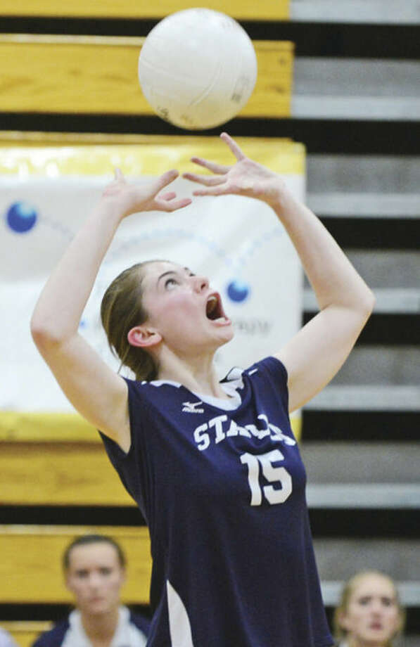 Hour photo / Erik TrautmannAriana Sherman of Staples gets to the ball during their semifinal volleyball game against Darien Wednesday in Fairfield.
