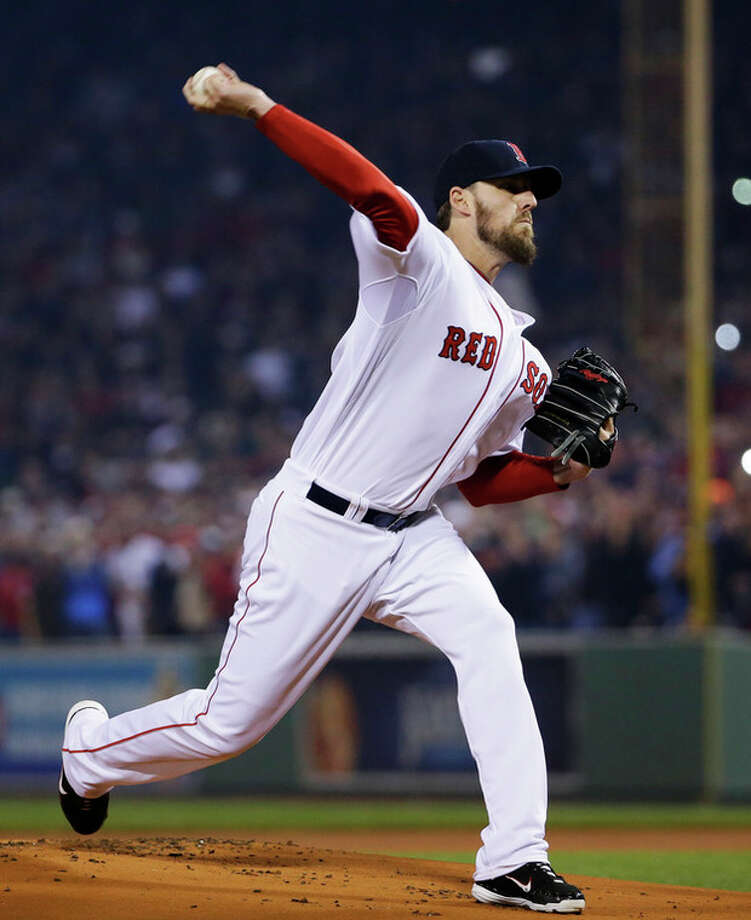 Boston Red Sox starting pitcher John Lackey throws during the first inning of Game 6 of baseball's World Series against the St. Louis Cardinals Wednesday, Oct. 30, 2013, in Boston. (AP Photo/Matt Slocum) / AP