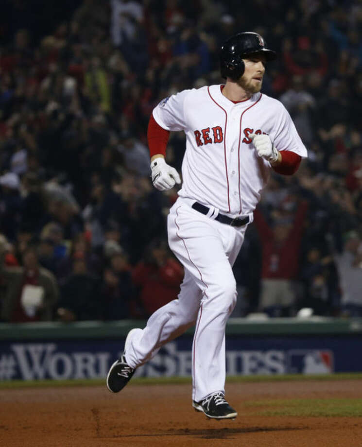 Boston Red Sox shortstop Stephen Drew runs around the infield after hitting a home run against St. Louis Cardinals starting pitcher Michael Wacha during the fourth inning of Game 6 of baseball's World Series Wednesday, Oct. 30, 2013, in Boston. (AP Photo/Elise Amendola)