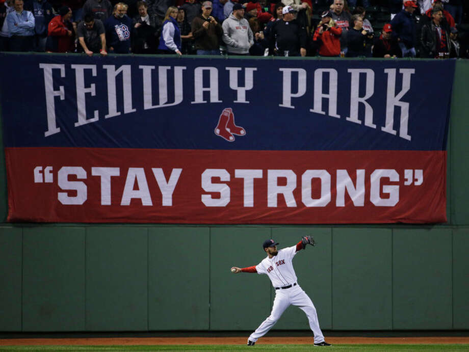 Boston Red Sox starting pitcher John Lackey warms up before Game 6 of baseball's World Series against the St. Louis Cardinals Wednesday, Oct. 30, 2013, in Boston. (AP Photo/Matt Slocum) / AP