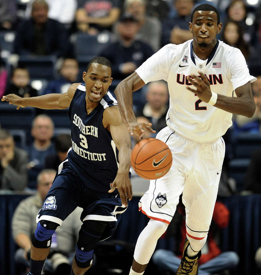Connecticut's DeAndre Daniels, right, pushes ahead of Southern Connecticut's Michael Mallory, left, during the first half of an NCAA college basketball game, Wednesday, Oct. 30, 2013, in Storrs, Conn. (AP Photo/Jessica Hill) / FR125654 AP