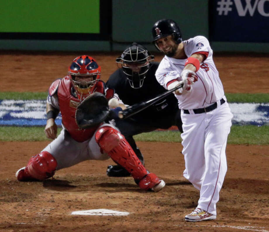 Boston Red Sox's Shane Victorino hits an RBI ingle during the fourth inning of Game 6 of baseball's World Series against the St. Louis Cardinals Wednesday, Oct. 30, 2013, in Boston. (AP Photo/Charlie Riedel) / AP