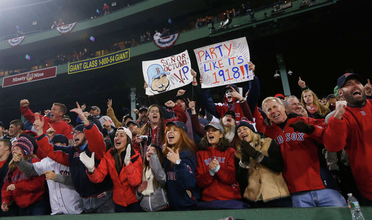 Boston Red Sox fans celebrate after winning the championship over the St. Louis Cardinals in Game 6 of baseball's World Series Thursday, Oct. 31, 2013, in Boston. The Red Sox won 6-1 to win the series. (AP Photo/Elise Amendola)