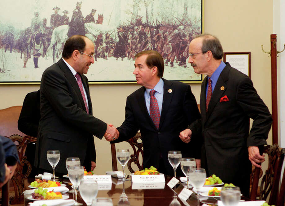 Iraq's Prime Minister Nouri al-Maliki, left, is greeted by House Foreign Affairs Committee Chairman Rep. Ed Royce, R-Calif., center, and the committee's ranking Democrat Rep. Eliot Engel, D-N.Y., on Capitol Hill in Washington, Wednesday, Oct. 30, 2013, during a luncheon meeting. (AP Photo/Molly Riley) / FR170882 AP