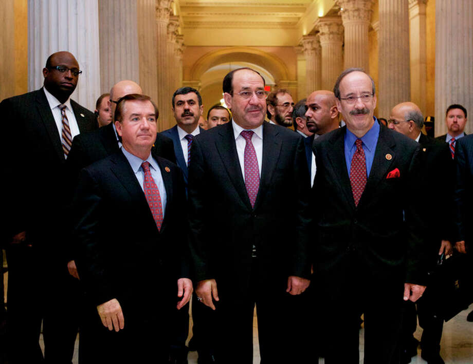 Iraq's Prime Minister Nouri al-Maliki, center, walks with Rep. Eliot Engel, D-N.Y., right, and Rep. Ed Royce, R-Calif., on Capitol Hill in Washington, Wednesday, Oct. 30, 2013, before their meeting. Earlier, the prime minister met with Vice President Joe Biden. (AP Photo/Molly Riley) / FR170882 AP