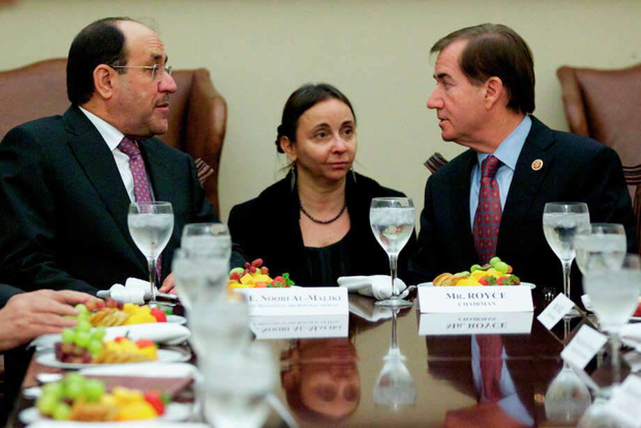 Iraq's Prime Minister Nouri al-Maliki, left, talks with House Foreign Affairs Committee Chairman Rep. Ed Royce, R-Calif., right, during a luncheon meeting on Capitol Hill in Washington, Wednesday, Oct. 30, 2013. (AP Photo/Molly Riley) / FR170882 AP