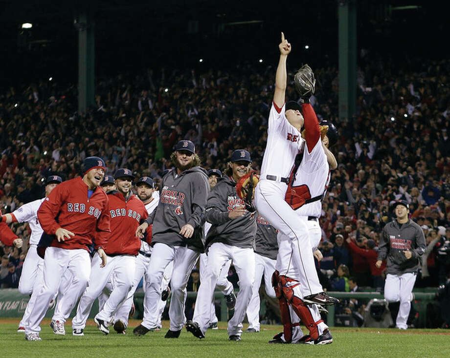 Boston Red Sox relief pitcher Koji Uehara and catcher David Ross celebrate after getting St. Louis Cardinals' Matt Carpenter to strike out and end Game 6 of baseball's World Series Wednesday, Oct. 30, 2013, in Boston. The Red Sox won 6-1 to win the series. (AP Photo/Matt Slocum) / AP