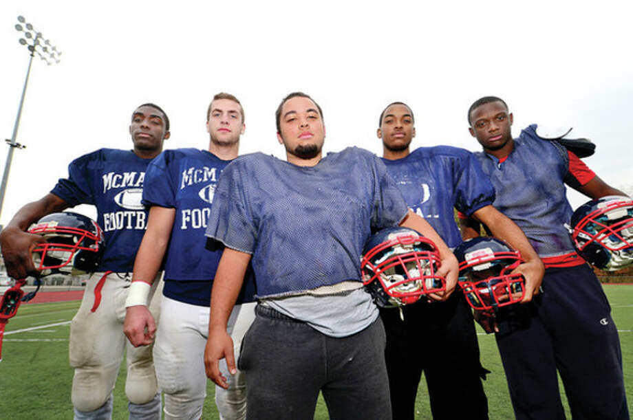 Hour photo / Erik Trautmann McMahon defensive linemen; Allan Lenard, Matt Hargrove, Mike Bottex, David Daniel and Rutho Charlot. / (C)2013, The Hour Newspapers, all rights reserved