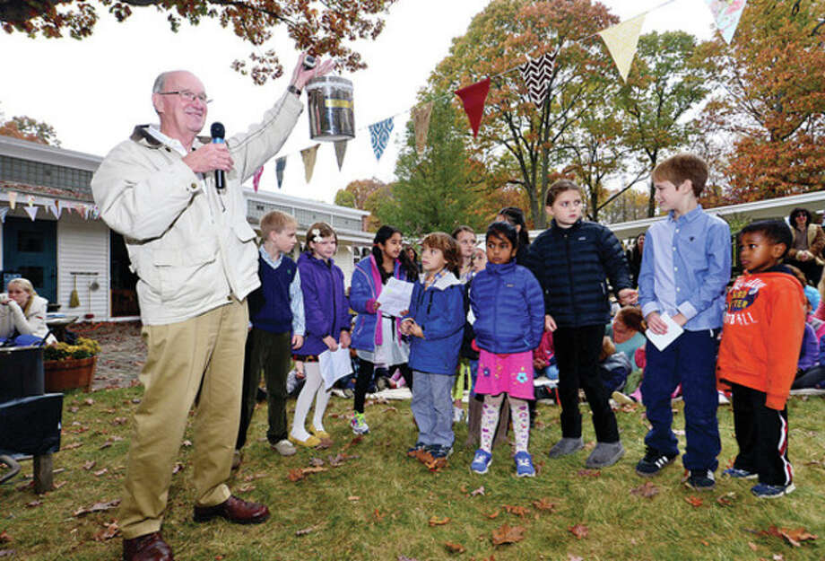 Hour photo / Erik Trautmann The Montessori School interim headmaster David Blanchard displys the schhols time capsule to be buried as part of the school's 50th anniversary celebration in Wilton Thursday. / (C)2013, The Hour Newspapers, all rights reserved