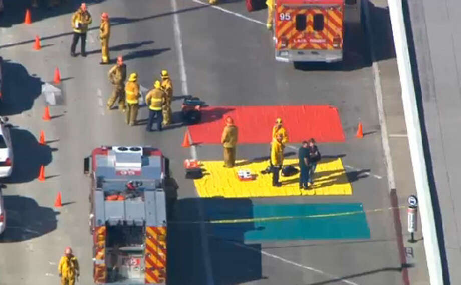 In this aerial video frame grab provided by CBS-LA, fire and rescue personnel gather at Los Angeles International Airport on Friday Nov. 1, 2013. Shots were fired Friday at Los Angeles International Airport, prompting authorities to evacuate a terminal and stop flights headed for the city from taking off from other airports. (AP Photo/CBS-LA)