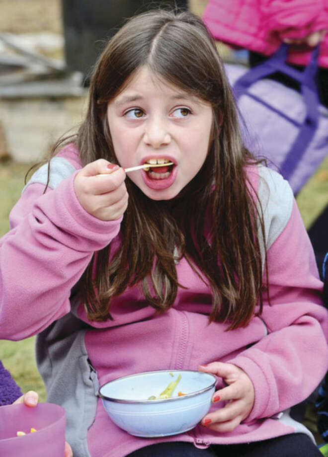 Hour photo / Erik Trautmann The Montessori School 3rd grader Ella Grob has some homemade soup during their Harvest festival as part of the school's 50th anniversary celebration in Wilton Thursday.