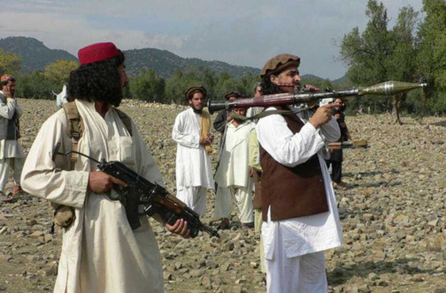 FILE - In this Sunday, Oct. 4, 2009 file photo, Pakistani Taliban chief Hakimullah Mehsud, right, holds a rocket launcher with his comrades in Sararogha of Pakistani tribal area of South Waziristan along the Afghanistan border. Intelligence officials said Friday, Nov. 1, 2013 that the leader of the Pakistani Taliban Hakimullah Mehsud was one of three people killed in a U.S. drone strike. (AP Photo/Ishtiaq Mehsud, File) / AP
