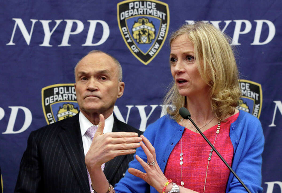 Mary Wittenberg, president and CEO of the New York Road Runners, accompanied by New York City Police Commissioner Raymond Kelly, left, discusses security plans for the Sunday's New York City Marathon during a news conference at police headquarters, in New York, Friday, Nov. 1, 2013. (AP Photo/Richard Drew)