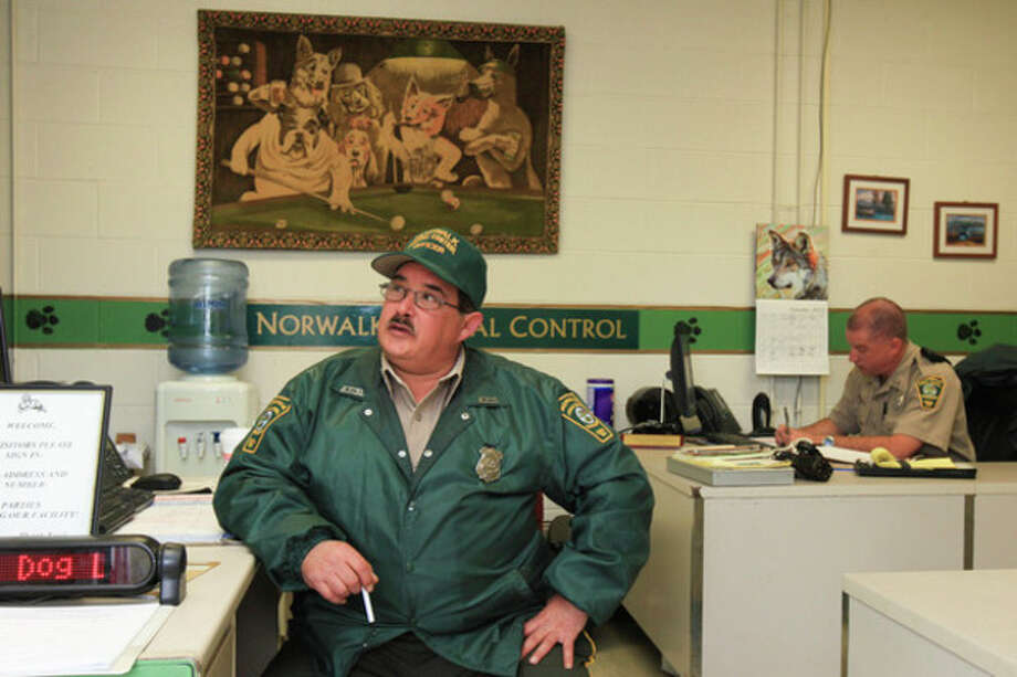 Hour Photo / Chris PalermoAnimal Control Supervisor Richard Duddie, left, and Assistant Dog Warden Bob Sirico at the Norwalk Animal Control offices Tuesday afternoon. / © 2013 Hour Newspapers All Rights Reserved