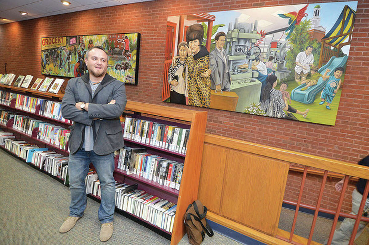 Hour Photo/Alex von Kleydorff Duvian Montoya talks about the family that infuenced his Mural, 'Norwalk Migration' as its unveiled at the Norwalk Public Library.