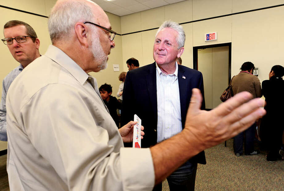 Hour photo / Erik Trautmann Mayoral candidate Harry Rilling talks with chairman of Norwalk Reads! Stephen Bentkover as Rilling campaigns at their event at the Norwalk Public Library on Belden Ave Saturday.