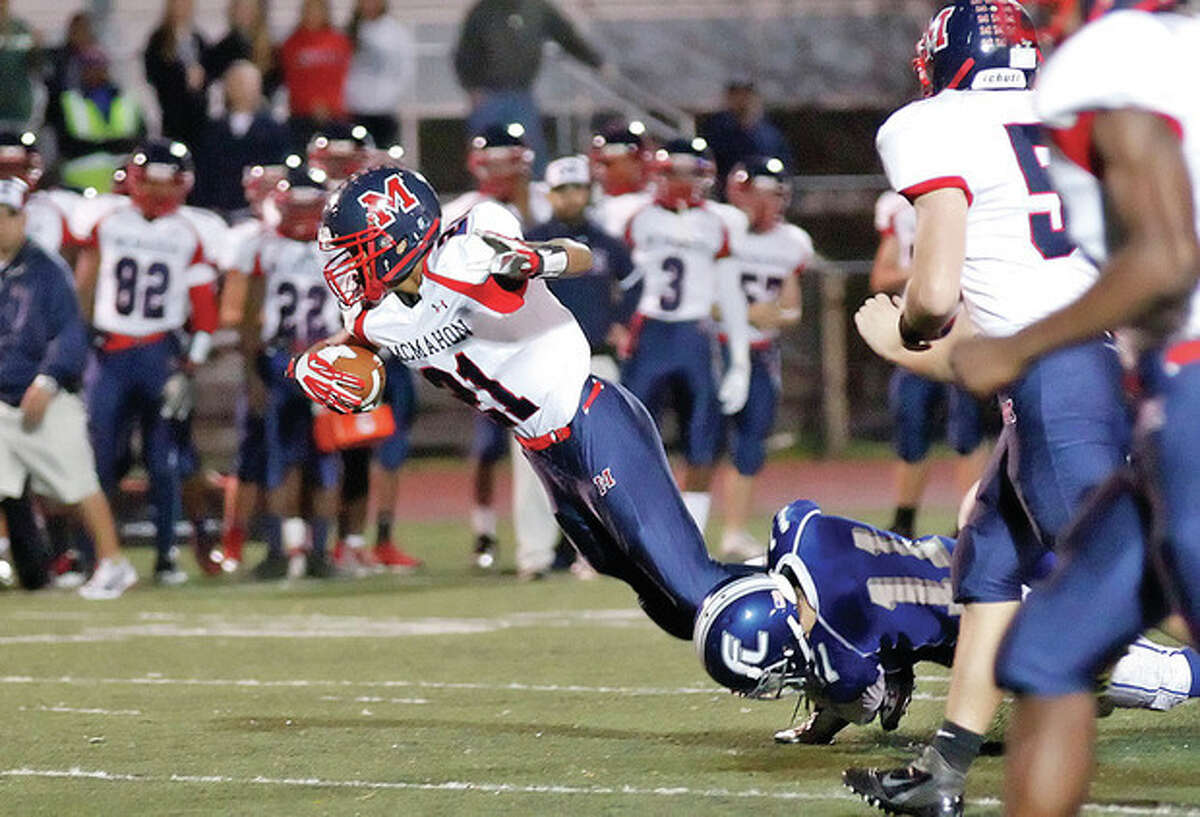 Brien McMahon's #21, Timmy Hinton, gets tackled during an away game against Fairfield Ludlowe at Taft Field Friday evening. Hour Photo / Danielle Calloway