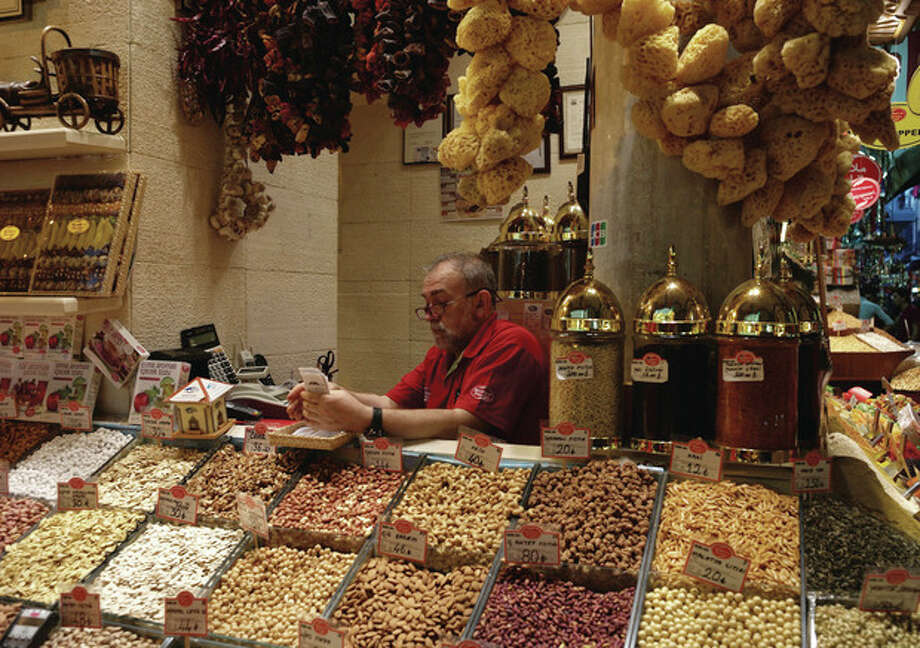 "AP PhotoA man sits in his shop in the 17th century Spice Market, or the Egyptian Bazaar, with stalls beautifully displaying spices, dried fruit, nuts, apple tea, essential oils, and ""Turkish Delight""; candy in Istanbul, Turkey, Tuesday, Oct. 29. Last summer, Istanbul's Taksim Square was the scene of violent confrontations between police and protesters. But protests have faded, and contrary to some lingering perceptions, it's quite calm now - except for the normal hustle and bustle found in this vibrant city. / AP"