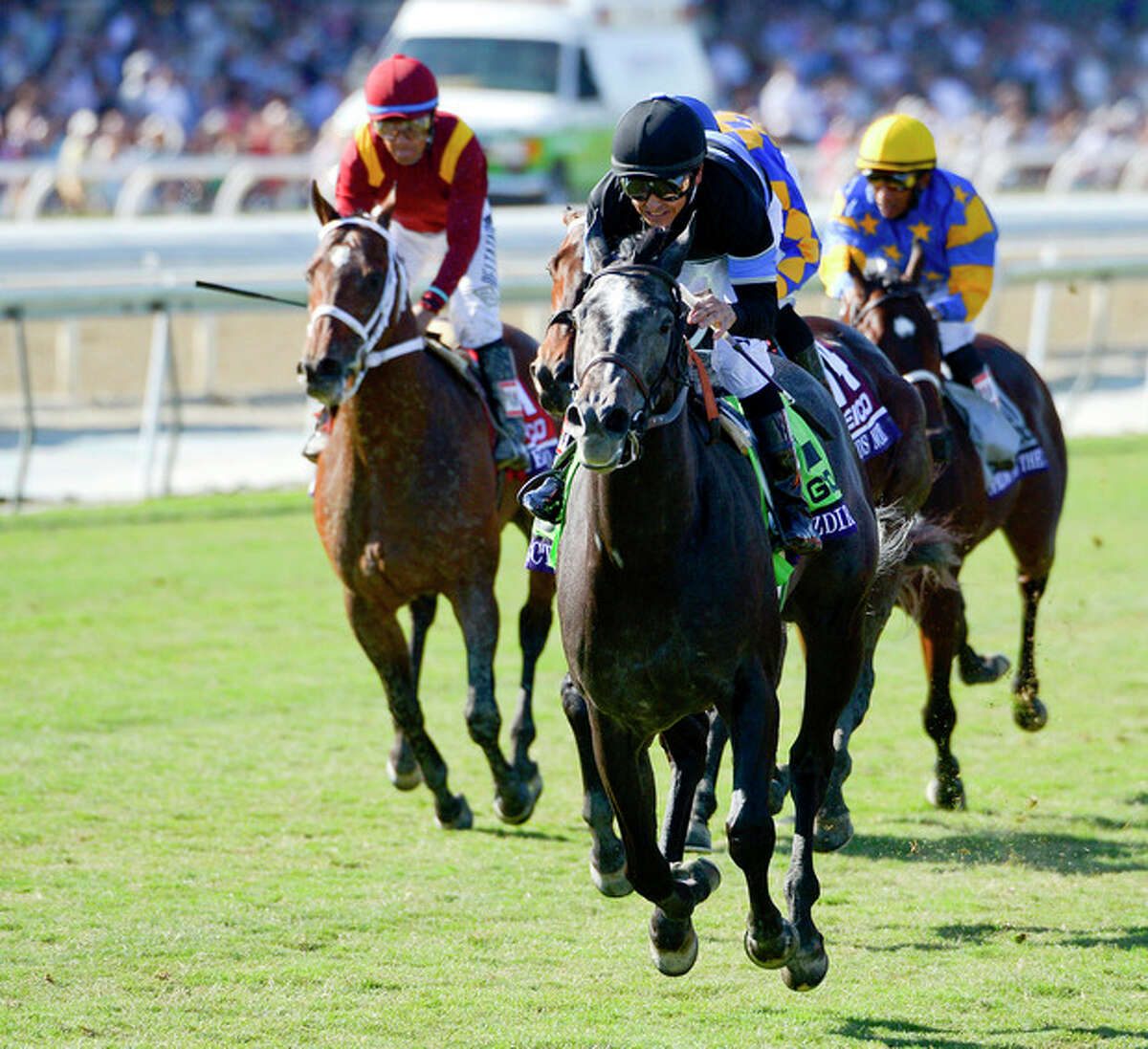 Jockey Mike Smith rides Mizdirection to a first place finish in the Breeders' Cup Juvenile Fillies horse race at Santa Anita Park Saturday, Nov. 2, 2013, in Arcadia, Calif. (AP Photo/Mark J. Terrill)