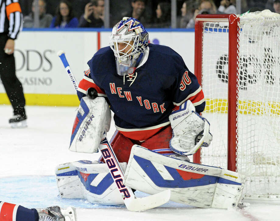 New York Rangers goaltender Henrik Lundquist, of Sweden, makes a save during the first period of an NHL hockey game against the Carolina Hurricanes on Saturday, Nov. 2, 2013, at Madison Square Garden in New York. (AP Photo/Bill Kostroun) / FR51951 AP