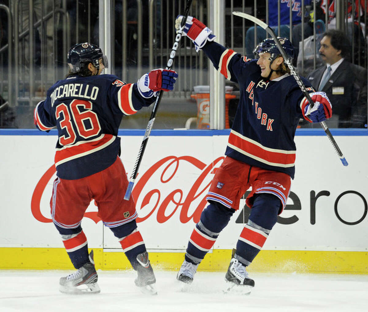 New York Rangers' Carl Hagelin, right, celebrates his goal with Mats Zuccarello during the second period of an NHL hockey game against the Carolina Hurricanes on Saturday, Nov. 2, 2013, at Madison Square Garden in New York. (AP Photo/Bill Kostroun)