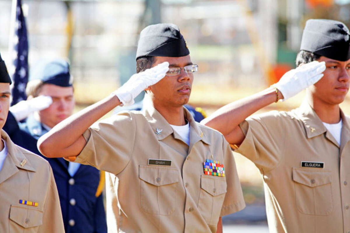 Dhruvil Shah of Brien McMahon's NJROTC salutes during the American Legion Hall's Veteran of the Month ceremony Sunday morning. Hour Photo / Danielle Calloway