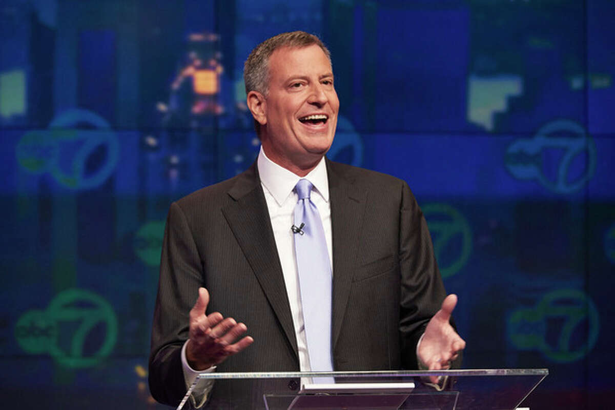 FILE - In this Oct. 15, 2013 file photo, New York City Democratic mayoral candidate Bill de Blasio speaks during first televised debate against Republican mayoral candidate Joe Lhota at WABC/Channel 7 studios in New York. As other candidates were felled by scandal and campaign missteps, the unabashed liberal emerged as the unlikely victor on the Democratic ticket. (AP Photo/The Daily News, James Keivom, Pool)