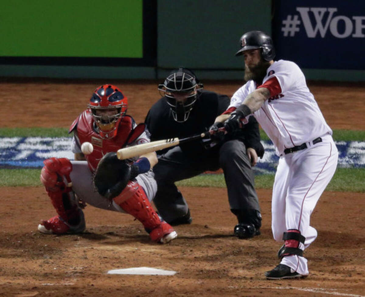 Boston Red Sox's Mike Napoli hits an RBI single during the fourth inning of Game 6 of baseball's World Series against the St. Louis Cardinals Wednesday, Oct. 30, 2013, in Boston. (AP Photo/Charlie Riedel)