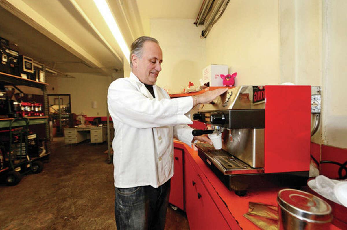 Hour photo / Erik Trautmann Joe Santolo at Oasis Coffee brews an espresso at their Norwalk facility.