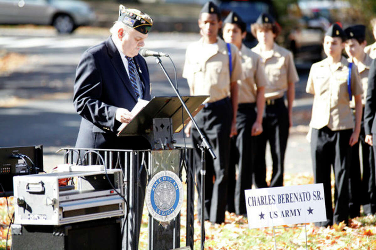 Leo Motyka speaks about Charles Berenato Sr. at the American Legion Hall's Veteran of the Month ceremony Sunday morning. Hour Photo / Danielle Calloway