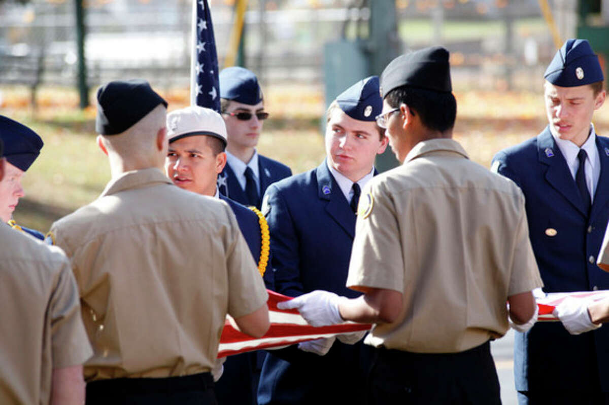 Noah Parks, NHS Airforce NROTC, prepares to fold a flag during the American Legion Hall's Veteran of the Month ceremony Sunday morning. Hour Photo / Danielle Calloway