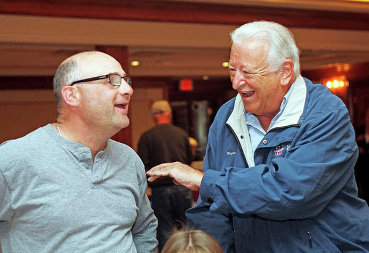 Hour photos / Danielle Calloway At right, Mayor Richard Moccia speaks to Rick Baumblatt at the Norwalk Inn during the Lions Club Breakfast Sunday morning. At far right, Moccia speaks to James Baumblatt, 11, at the breakfast.