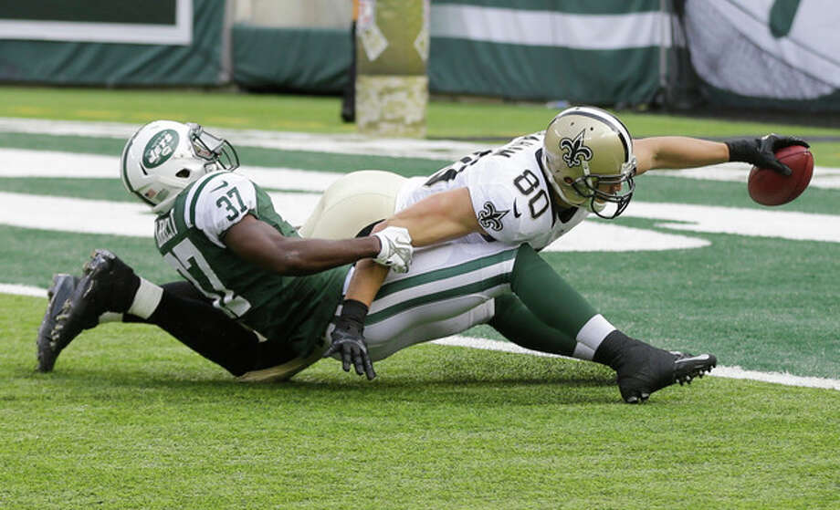 New Orleans Saints tight end Jimmy Graham (80) dives forward for a touchdown as New York Jets free safety Jaiquawn Jarrett (37) attempts to stop him during the first half of an NFL football game Sunday, Nov. 3, 2013, in East Rutherford, N.J. (AP Photo/Mel Evans) / AP
