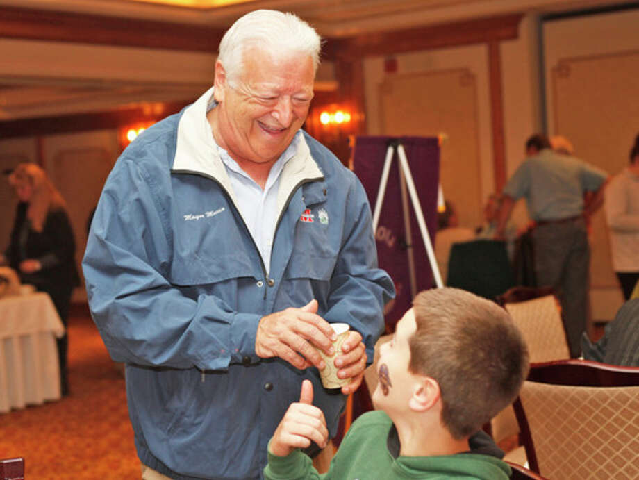 Mayor Moccia speaks to James Baumblatt, 11, at the Norwalk Inn during The Lion's Club Breakfast Sunday morning.Hour Photo / Danielle Calloway