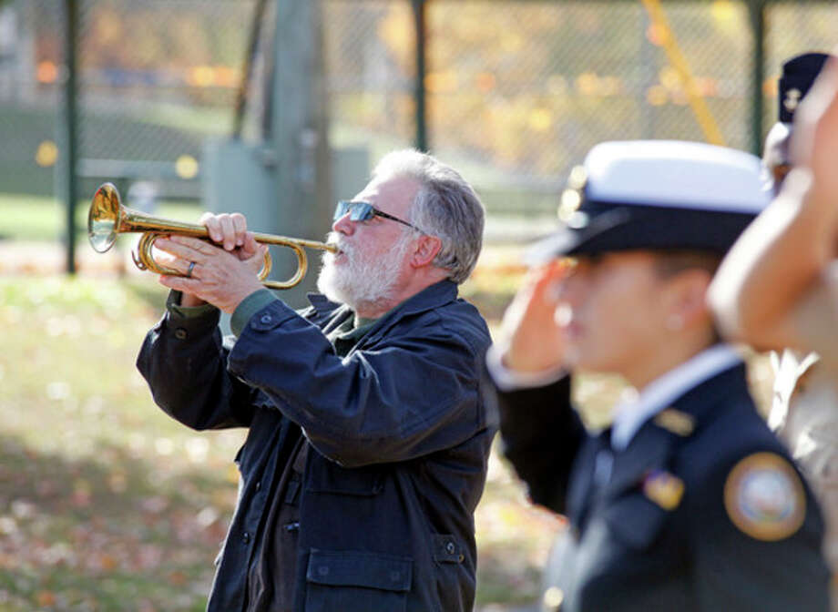 Reed Corbo plays Taps at the American Legion Hall's Veteran of the Month ceremony Sunday morning.Hour Photo / Danielle Calloway