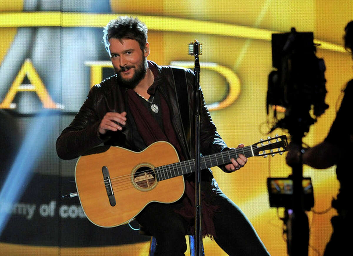 FILE - In this April 7, 2013 file photo, singer Eric Church performs at the 48th Annual Academy of Country Music Awards at the MGM Grand Garden Arena in Las Vegas. Church will be playing his new single, the hard rock anthem