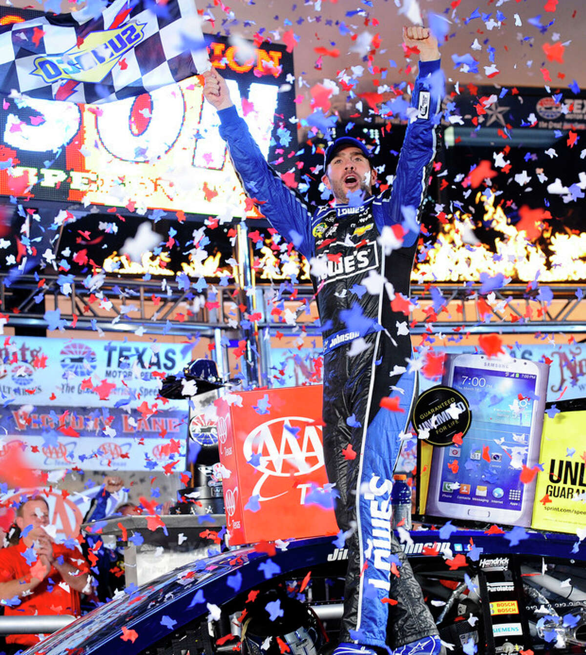 Jimmie Johnson (48) celebrates winning the NASCAR Sprint Cup series auto race at Texas Motor Speedway in Fort Worth, Texas, Sunday, Nov. 3, 2013. (AP Photo/Ralph Lauer)