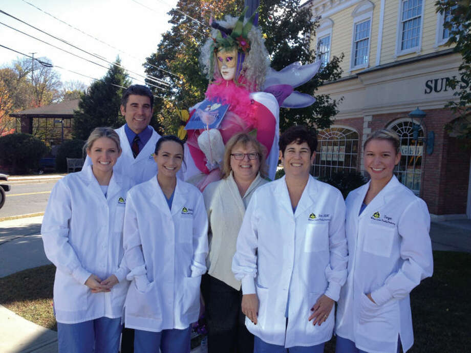 The Wilton Chamber of Commerce recently awarded Wilton Center Family Dentistry best overall Scarecrow for 2013. Pictured with Dr. James Aris (rear) from left to right are: Laura Clements, Natalie Wall, Judy Klem, Sue Rhieu, and Tanya Ralph.
