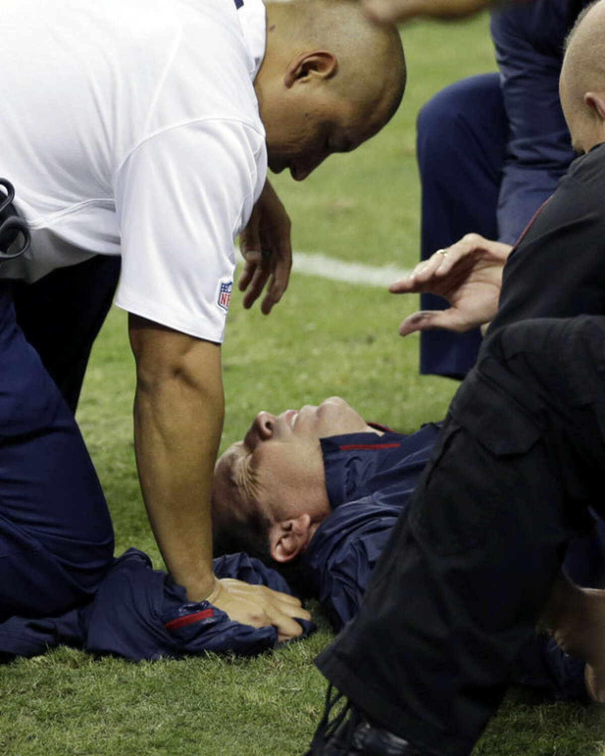 Houston Texans head coach Gary Kubiak, center, is helped after he collapsed on the field during the second quarter of an NFL football game against the Indianapolis Colts, Sunday, Nov. 3, 2013, in Houston. (AP Photo/David J. Phillip)