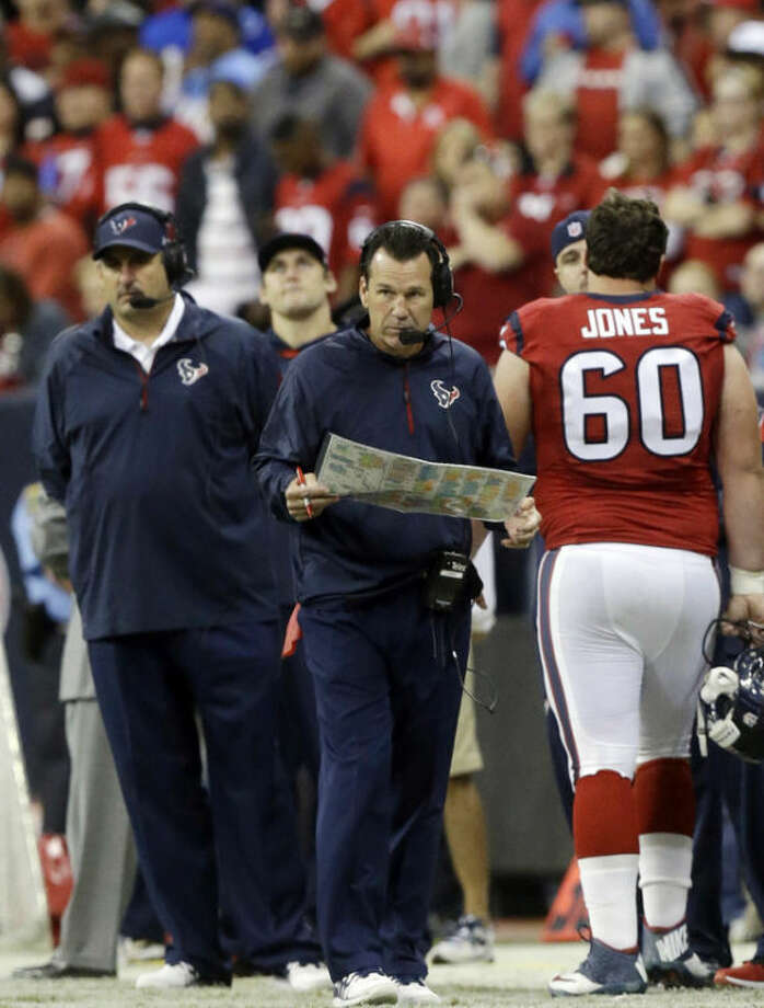 Houston Texans head coach Gary Kubiak watches from the sidelines during the first quarter of an NFL football game against the Indianapolis Colts, Sunday, Nov. 3, 2013, in Houston. (AP Photo/Patric Schneider)